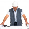 Engineer with white helmet and blueprints - Stock Photo