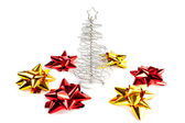 Christmas tree with red and gold bows — Stock Photo