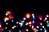 Defocused abstract colorful christmas lights — Stock Photo