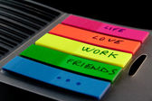 Post-it with the words life love work friends — Stock Photo