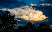 Stormy sky cloudscape with storm clouds silhouette and sunlight — Stock Photo