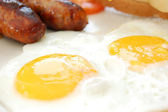 Tasty sausages and eggs — Stock Photo