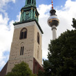 Marienkirche (St.Mary's Church) and the TV Tower in Berlin — Stock Photo