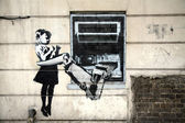 "Banksy Graffiti ""Cash Machine"" — Stock Photo"