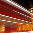 Royalty-Free Stock Photo: Light Trails Passing the Houses of Parliament.
