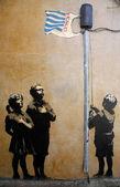 "Banksy Graffiti ""Pledging Allegiance to Tesco"" — Stock Photo"