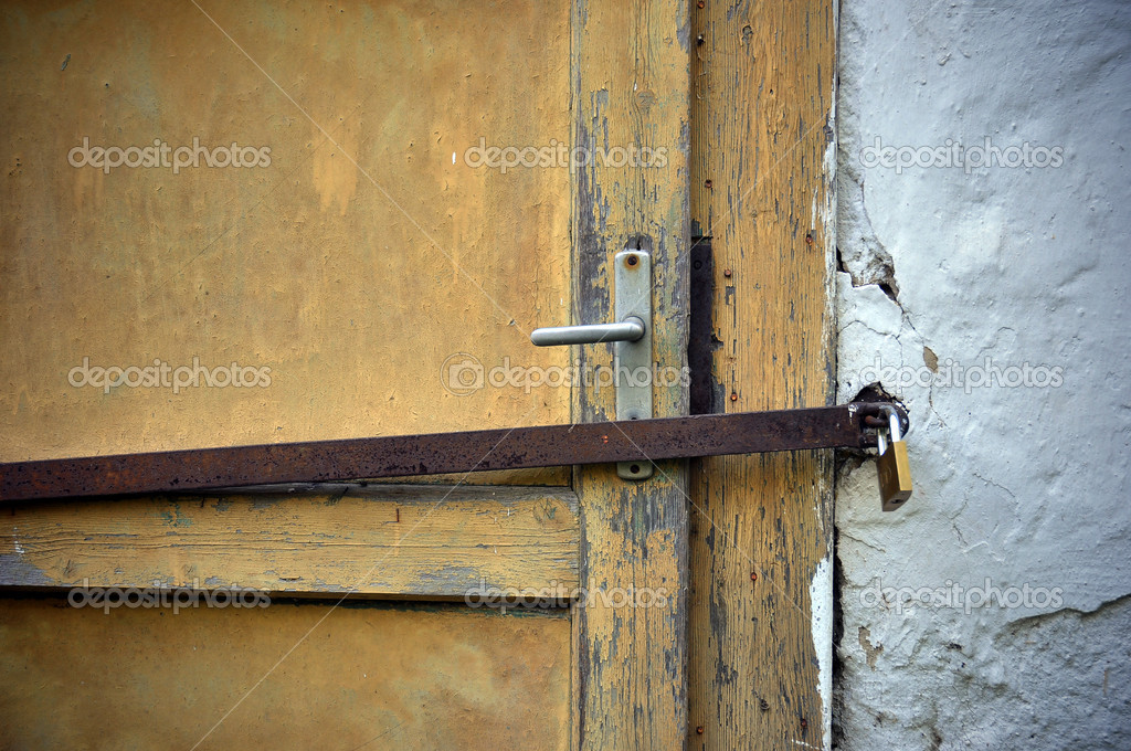 Abandoned house's closed door — Stock Photo #6952922