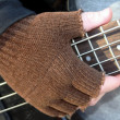 Gloved Hand on Frets — Stock Photo