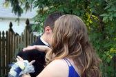 Brushing Off Shoulder Of Tuxedo — Stock Photo