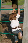 Little Girl Climbing 2 — Stock Photo