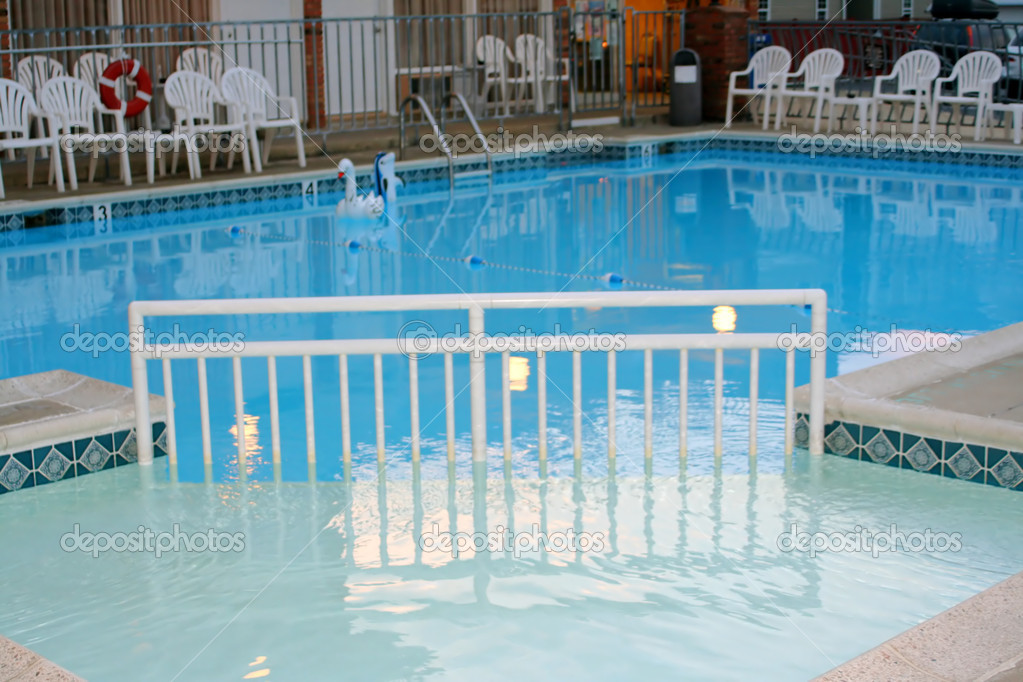 Cross-view of a motel pool.  Stock Photo #6848270