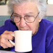 Senior Woman Sipping Coffee — Stock Photo
