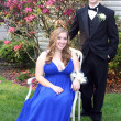 Smiling Prom Couple Sitting In Yard — Stock Photo #6850639