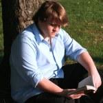 Teen Boy Reading In Park — Stock Photo