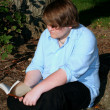 Stock Photo: Teen Reading Outdoors