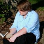 Teen Reading Outdoors — Stock Photo