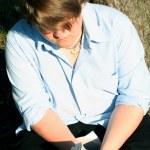 Teenage Boy Reading Outdoors — Stock Photo