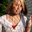 Young Blond Woman With Fence Shadows — Stock Photo #6851744