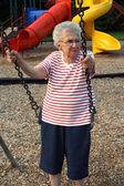 Swinging Grandmother — Stock Photo