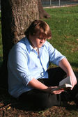 Teen Boy Reading In Park — Stock Photo