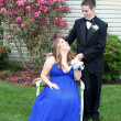 Prom Girl Seated Smiling at Date — Stock Photo #7150375