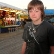 Sad Teen On Festive Boardwalk — Stockfoto #7742353