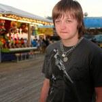 Sad Teen On Festive Boardwalk — Stock Photo #7742353