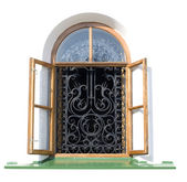 Open window with decorative grille — Stock Photo
