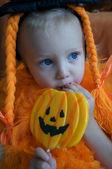 Baby girl on halloween day — Stock Photo