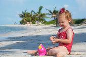 Baby girl on the beach — Stock Photo