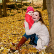 A mother and a daughter in fall — Stock Photo #7207806