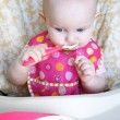 Baby eating cereal — Stockfoto