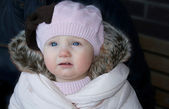 A beautiful baby girl in winter outfit — Stock Photo