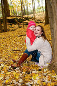 A mother and a daughter in fall — Stock Photo