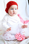 A cute baby girl in red hat — Stockfoto