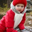 A cute baby girl in snowsuit — Stock Photo