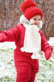 A baby girl in red snowsuit — Stock Photo