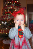 A baby girl on christmas eve — Stock Photo