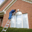 Painter painting trim around doors windows — Stock Photo #6747755