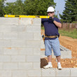 Stock Photo: Mason with Concrete Block