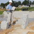 Mason with Concrete Block — Stock Photo #6747841
