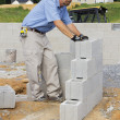 Mason with Concrete Block — Stock Photo