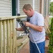 Stock Photo: Carpenter building porch rail