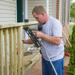 Carpenter building porch rail - Stock Photo