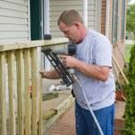 Carpenter building porch rail — Stock Photo