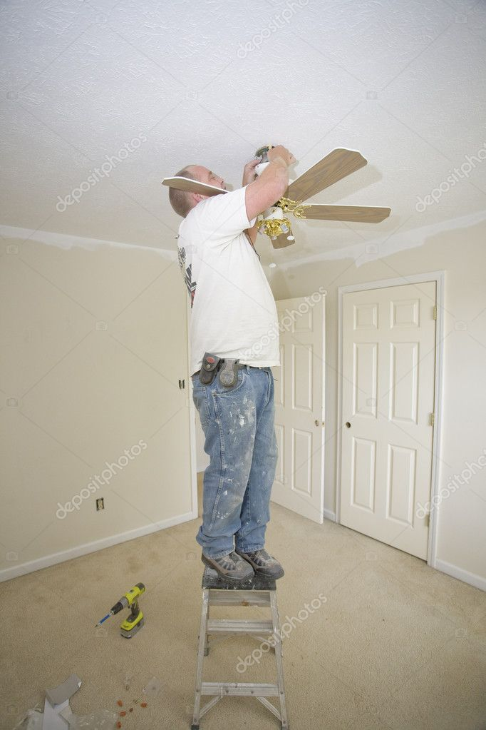 Electrician installing new light fixture and fan   Stock Photo #6754763