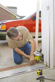 Carpenter sawing door casing — Stock Photo