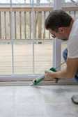 Caulking doors — Stock Photo