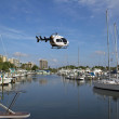 Stock Photo: Air Transport Helicopter Over Marina