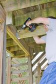 Carpenter securing deck — Stock Photo